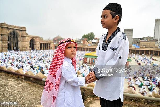 Two boys celebrate Eid Eid alFitr is the end of Ramazan and the first day of the month of Shawwal for all Muslims in Jama Masjid Ahmedabad