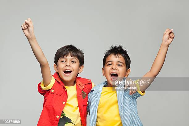 Two boys (6-7) cheering