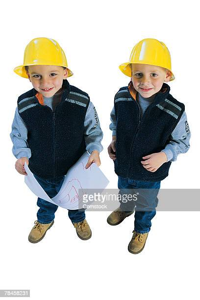 two boys dressed as engineers - kids costume engineer stock photos and pictures