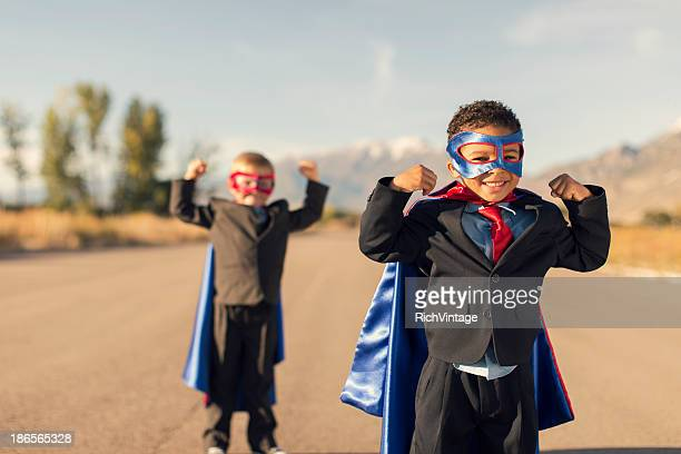 Two Boys Dressed in Business Suits and Superhero Outfits