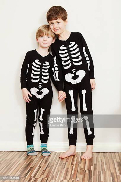 Two boys dressed in skeleton outfits