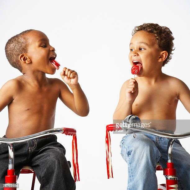 Two Boys Eating Lollipops