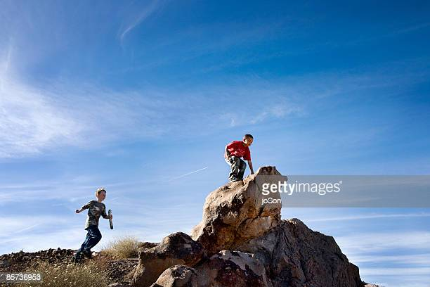 Two boys (8-10) exploring in nature