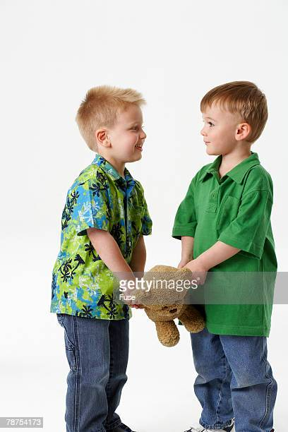 Two Boys Face to Face with Teddy Bear