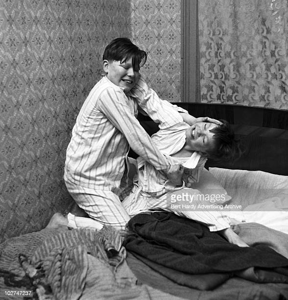 Two boys fighting in their bedroom 10th February 1958