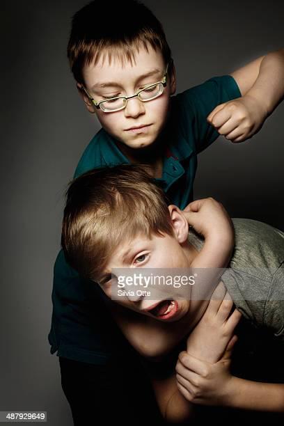 Two boys fighting, one in headlock
