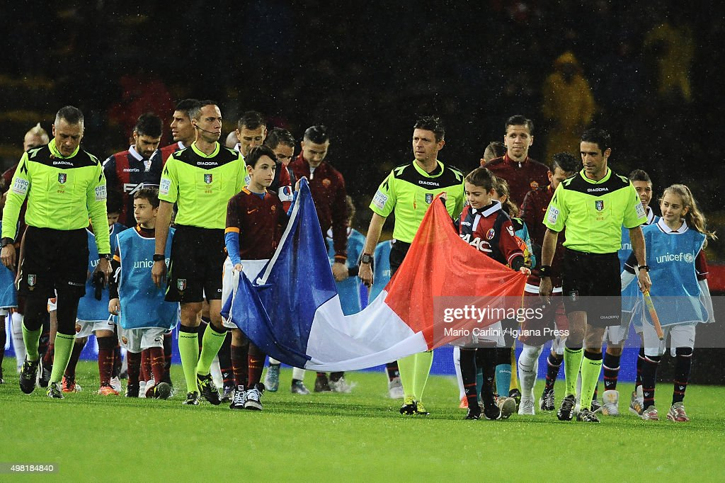 Two boys hold the National French flag as teams get on the pitch before the beginning of the Serie A match between Bologna FC and AS Roma at Stadio Renato Dall'Ara on November 21, 2015 in Bologna, Italy.