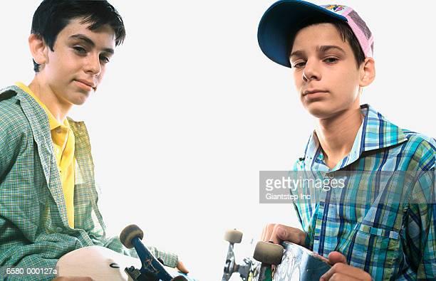 Two Boys Holding Skateboards
