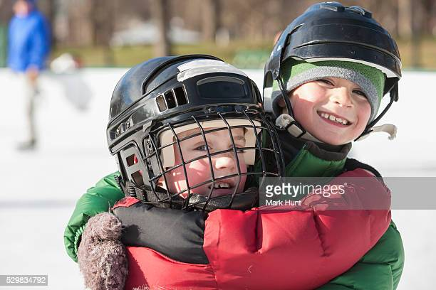 Two boys hugging after skating