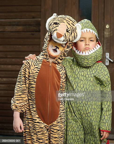 Two boys (5-7) in animal costumes, arms around each other, portrait