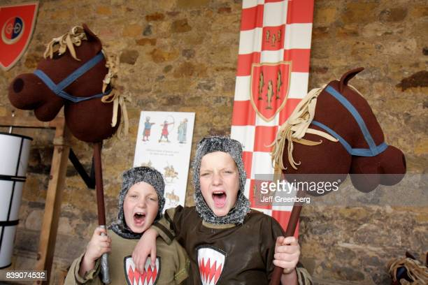 Two boys in Medieval knight costumes at Alnwick Castle