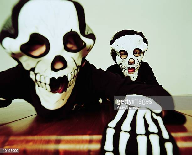 Two boys (5-7) in skeleton costumes, portrait, close-up
