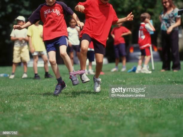 Two boys in three-legged race