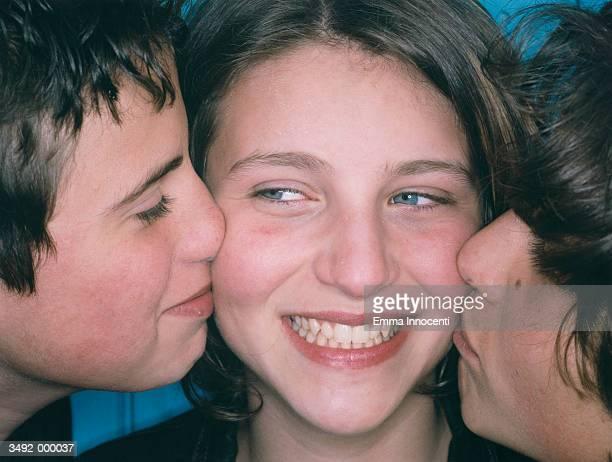 Two Boys Kiss Girl