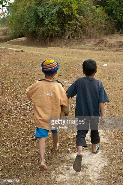 Two boys lead a clearance team from Phoenix Clearance LTD to a pair of phosphorous bombs they found near their village This village is scheduled to...