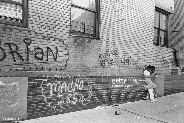 Two boys lean against a wall on a street in the Bronx New York City USA 1987