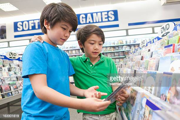 Two boys looking for DVDs to buy