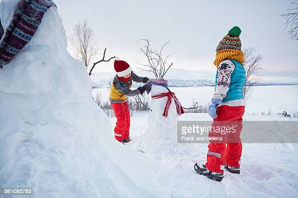 Two boys making snowmen , Hemavan,Sweden