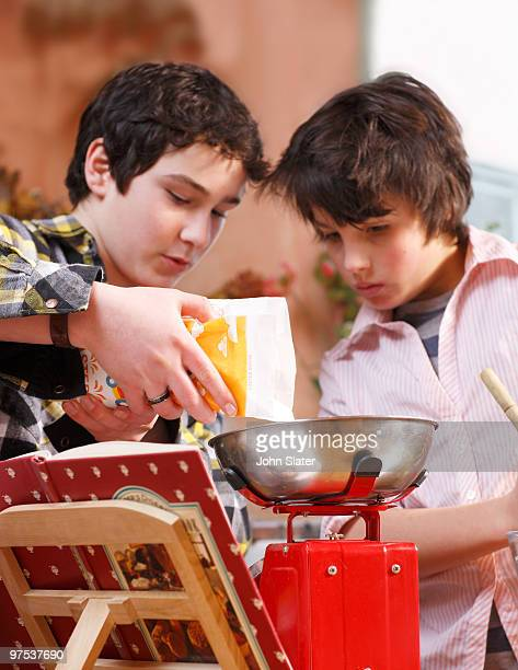 two boys measuring ingredients out