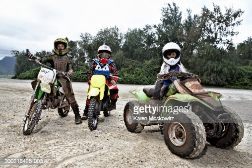Two Boys Sitting On Atv Stock Photo Getty Images