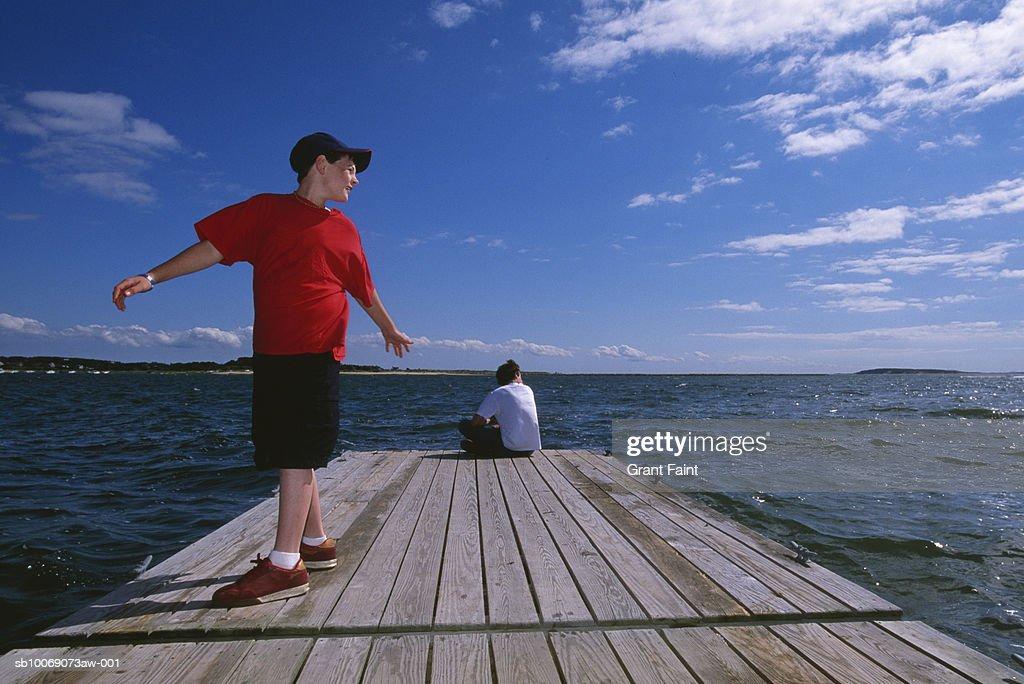 Two boys (10-16) on pier : Stockfoto
