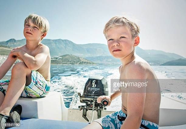 Two boys on speed boat