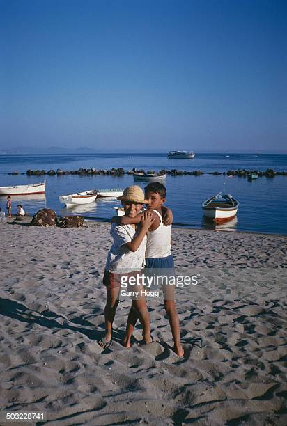 Two boys on the beach at Ischia an island in Italy 1963