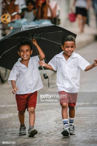 Two boys one umbrella Havana