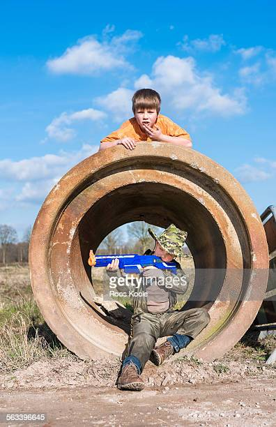Two boys play at a building site