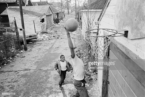 Two boys play basketball in the Poletown neighborhood of Detroit The ethnically diverse neighborhood is being razed to make room for a General Motors...
