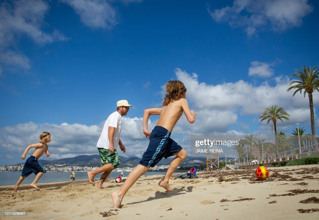 Two Boys Play Footbal With Their Father At Can Pere Antoni Beach In News Photo Getty Images