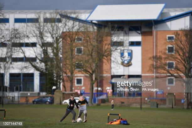 Two boys play football in Hillsborough Park outside Hillsborough, home of Sheffield Wednesday Football Club, following yesterday's announcement that...