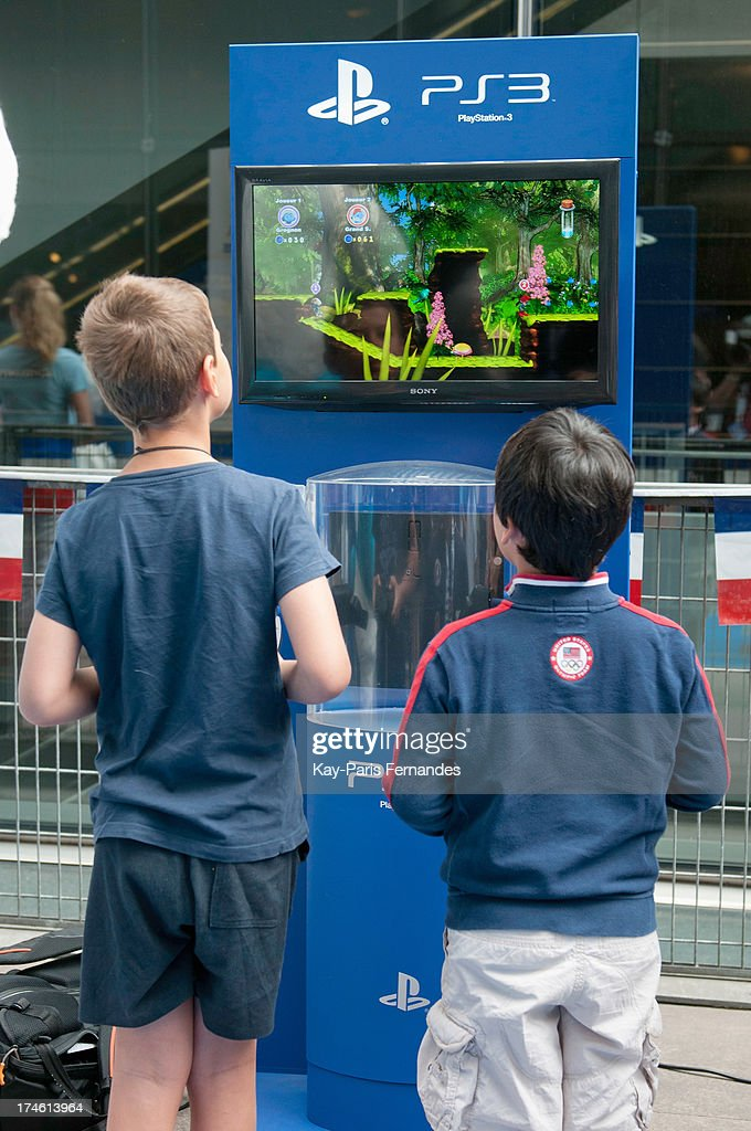 Two boys play the Smurfs video game on a games console at the 'Smurfs 2' Paris Premiere at UGC Cine Cite Bercy on July 28, 2013 in Paris, France.