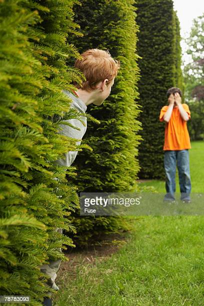 Two Boys Playing Hide and Seek