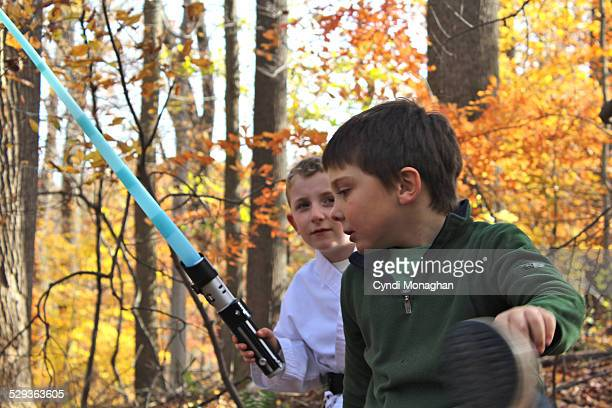 two boys playing imaginary games - lightsaber stock pictures, royalty-free photos & images