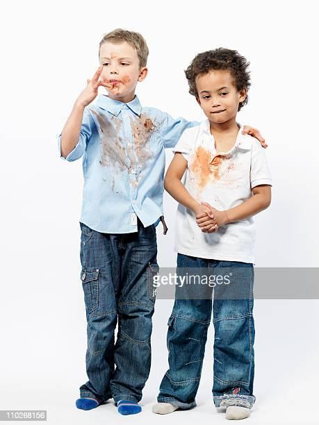 two boys playing with jam - mani incrociate foto e immagini stock