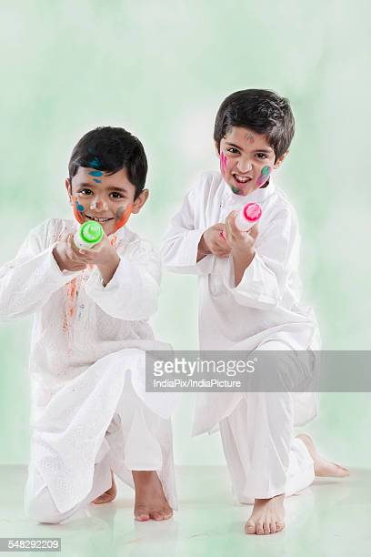 Two boys playing with pichkaris