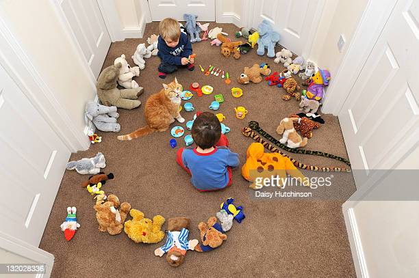 two boys playing with toy - toy animal stock photos and pictures