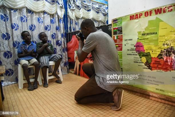 Two boys pose for a photo at Studio Alcatrace which is run by Abdul Karim Diallo in the Medina Coura region of Bamako Mali on February 27 2017 Diallo...