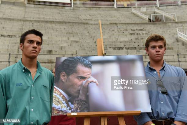Two boys pose with the picture of Ivan Fandiño during a funeral mass at 'Las Ventas' bullring in Madrid