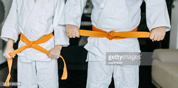 two boys practice judo - tighten stock pictures, royalty-free photos & images