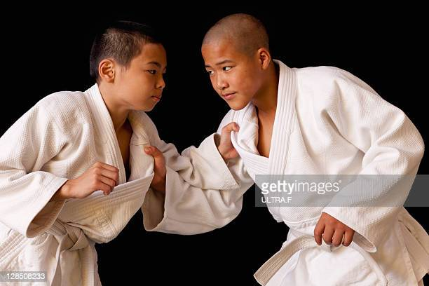 Two boys practising judo