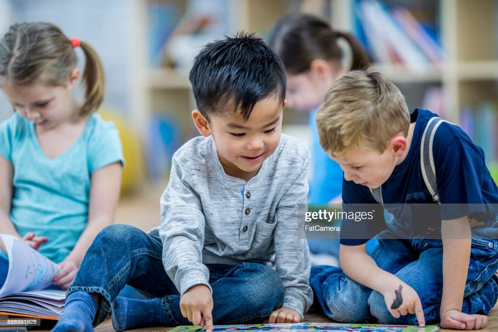 Two Boys Reading A Book : Stock Photo