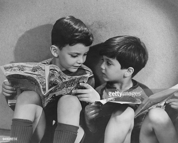 Two boys reading comics circa 1950
