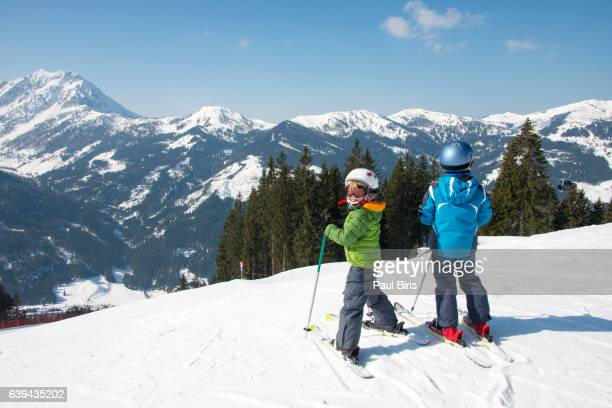 Two boys ready for skiing at Zauchensee ski-region, Austria