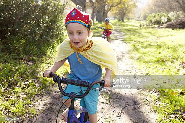 Two boys riding bicycles