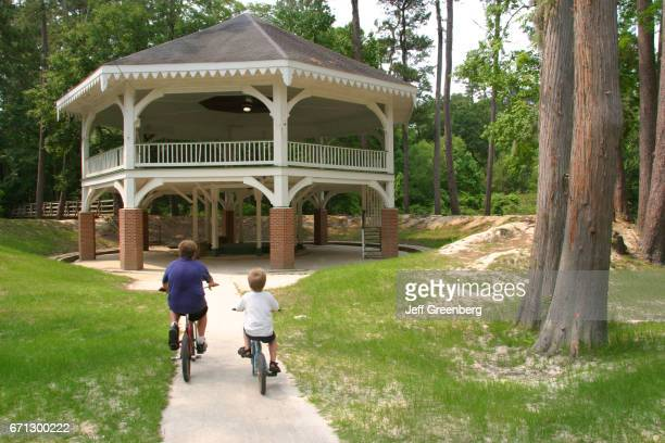 Two boys riding their bikes at Abita Springs Tourist Park