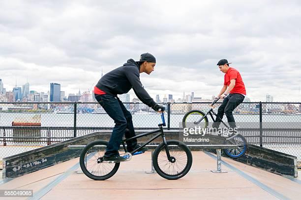 Two boys riding their BMX near NYC