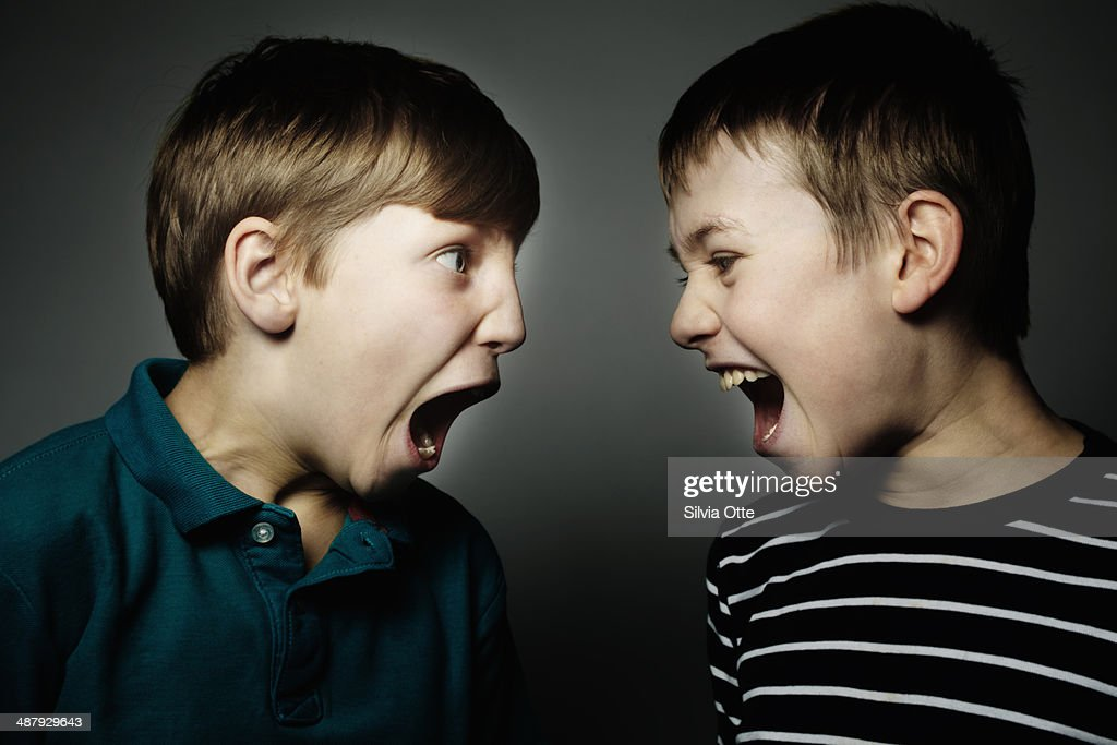 Two boys shouting at each other : Stock-Foto