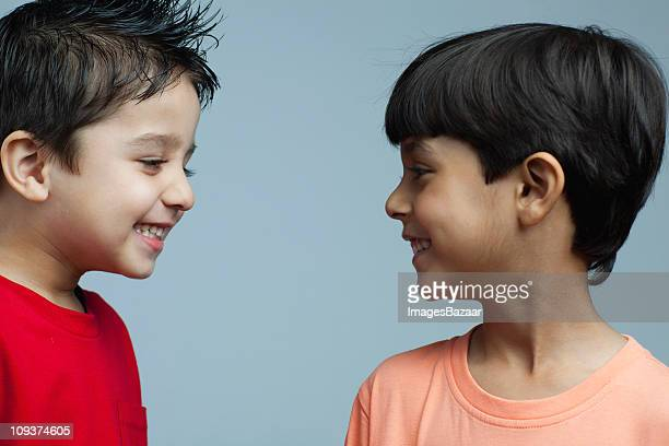Two boys (4-5, 6-7) smiling